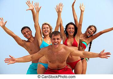 Excitement - Portrait of joyful guy and happy girls in...
