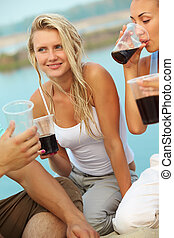 Party of friends - Image of happy girl with drink surrounded...