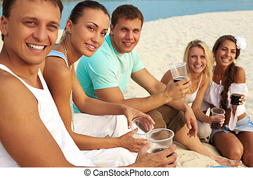 Having party - Image of happy friends with drinks having fun...
