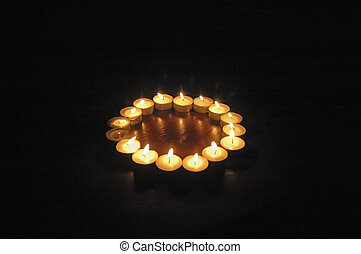 Lit candles creating a romantic atmosphere - Circle of lit...