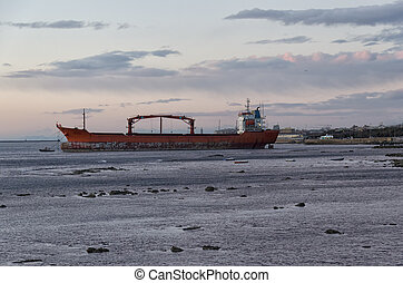 Cargo ship aground off the coast - View of cargo ship...