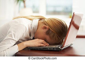 Exhausted - Image of very tired businesswoman or student...