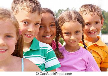 Preschoolers - Portrait of smart preschoolers standing in...