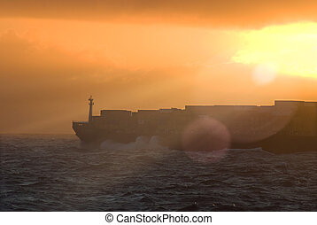 Large transatlantic container tanker on sunset