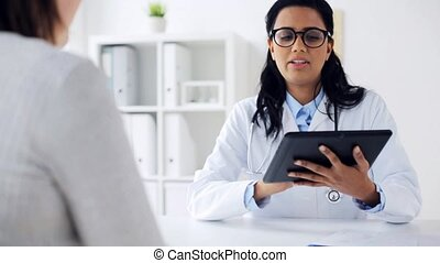 doctor with tablet pc and woman at hospital - medicine,...