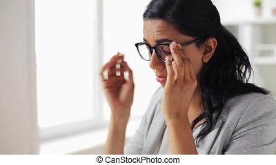 businesswoman rubbing tired eyes at office - business,...