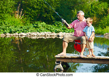 Summer fishing - Photo of grandfather and grandson on...