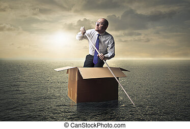 Man in box in the sea