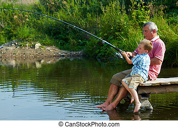 Weekend fishing - Photo of grandfather and grandson sitting...