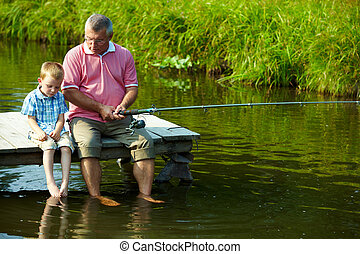 Fishing time - Photo of grandfather and grandson sitting on...