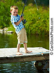 Kid fishing - Photo of little kid pulling rod while fishing...