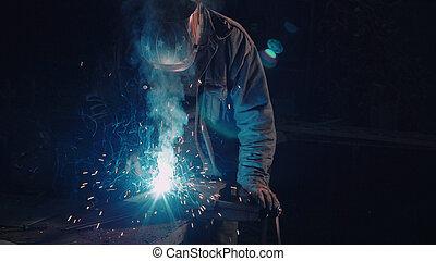 Smith welding metal details on black background