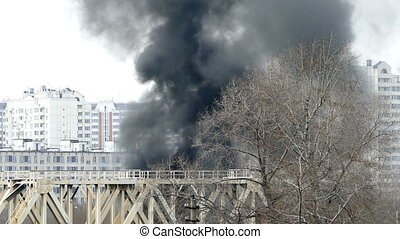 Fire in the city, black smoke