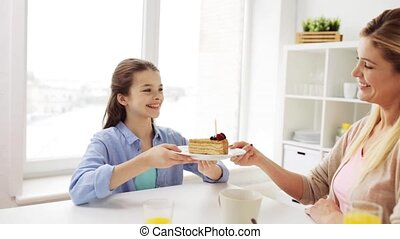 happy family with birthday cake at home kitchen - family,...
