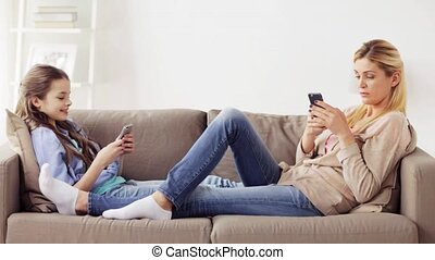 happy family with smartphones at home - people, family and...