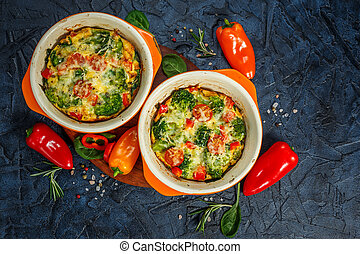 Frittata with broccoli in two ceramic forms - Frittata with...