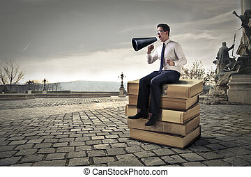 Businessman with megaphone outside