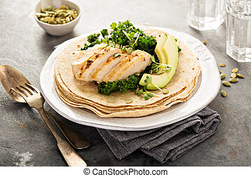 Making tacos with grilled chicken and avocado - Making tacos...