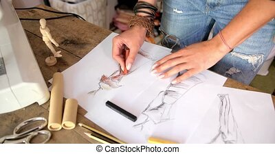 Tailor drawing sketches - Crop faceless shot of female...