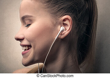 Woman listening to music - Smiling woman listening to music