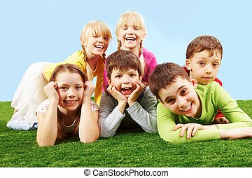 Children - Group of children lying on grass
