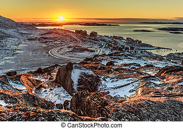 Beautiful Polar sunset, view from the hill to Nuuk fjord and new suburb of city, Greenland