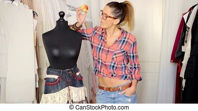 Tailor posing with mannequin - Young stylish tailor eating...