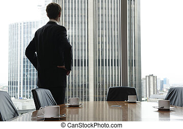 Boardroom - Single adult business man waiting for meeting to...