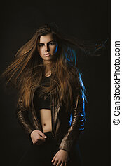 Glorious brunette lady with long hair in motion