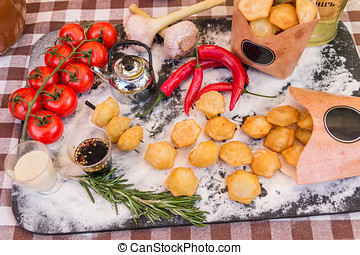 Cooking. Potatoes, flour, rosemary. Chili, tomatoes....