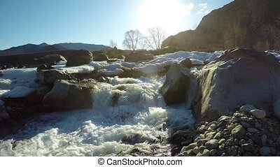 Spring high water on the creek Ilgumen at the confluence of...