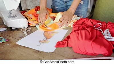 Crop seamstress choosing fabric for dress - Crop faceless...