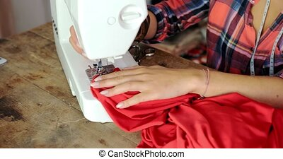 Crop shot of tailor in work - Crop faceless shot of female...