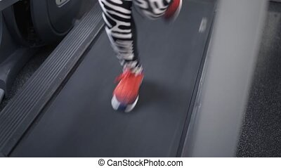 Close up of woman s legs on a treadmill