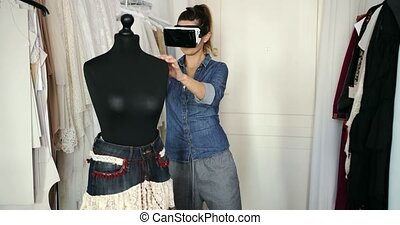 Female in VR headset working in parlour - Young casual...