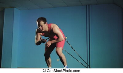 Battle ropes exercise in the gym slow mo