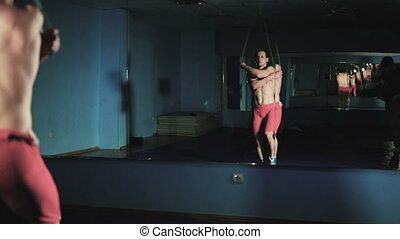 Wrestler is trained on a rope in the gym slow mo - Wrestler...
