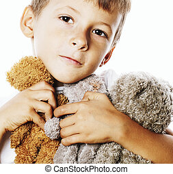 little cute boy with many teddy bears hugging isolated close...
