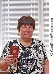 elderly woman  with a passport