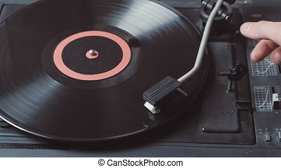 Record player playing vinyl, retro vinyl turntable stylus close up