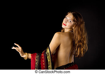 Pretty young woman with naked spine in traditional dress