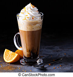Hot viennese coffee with whipped cream with orange zest