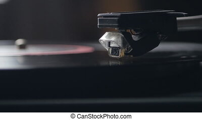 Record player turntable. A record player turntable with it's stylus running along a vinyl record