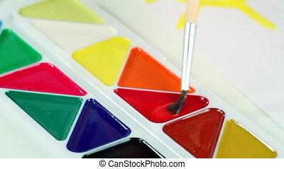 Little Boy Draws Paints - The little boy smears the paint...