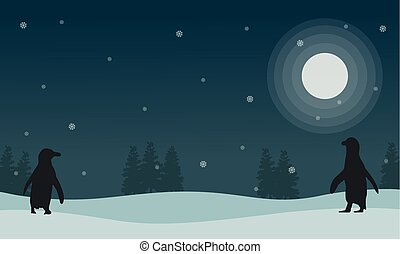 Snow scenery at night with penguin silhouettes