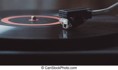 Vinyl rotating on a turntable. A record player turntable with it's stylus running along a vinyl record