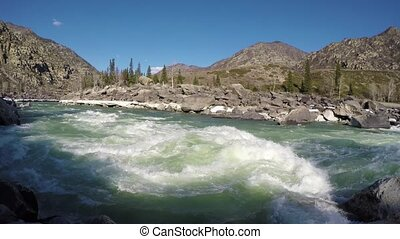 Spring high water on the Katun River in the Altai Mountains,...