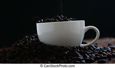 Slow motion of The roasted coffee beans fall into the white...