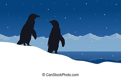 Landscape of penguin on ice silhouettes