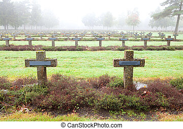 crosses at cemetery in autumn mist stone tombstones